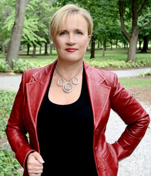 Portrait headshot of Dana Pharant wearing a red leather jacket