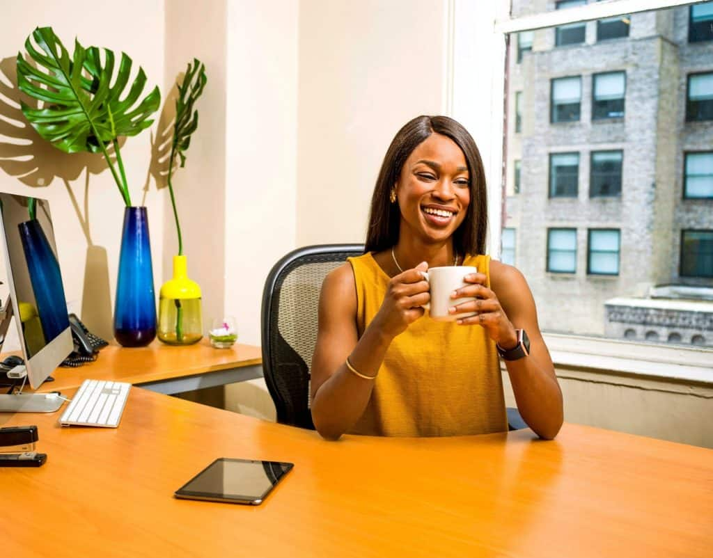 Business woman bringing positive impact to the office